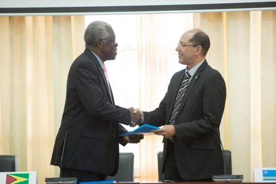 Director-General, Guyana Civil Aviation Authority, Retired Lieutenant Colonel, Egbert Field and Acting Director-General, Department of Civil Aviation, Aruba, Anthony Kirchner exchanges the MOU.