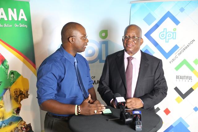 Minister of Finance, Winston Jordan and DPI's Paul McAdam during an interview.