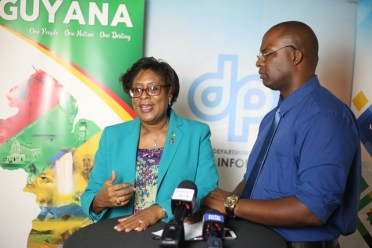 Minister of Public Telecommunications, Catherine Hughes and DPI's Paul McAdam during an interview.