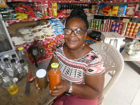 Lavern Padmori showcasing her bottled pepper and all-purpose seasoning.