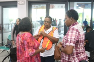 Minister within the Ministry of Public Infrastructure, Annette Ferguson meeting with passengers who were on board the Fly Jamaica flight which was bound to Toronto, Canada