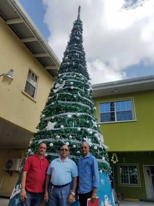 (from left to right) Region Three Regional Chairman, Julius Faerber, REO Denis Jaikarran along a Regional Councillor Nazeer Ahmad standing in front of the region's Christmas tree
