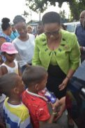 Minister of Public Health, Volda Lawrence distributing gifts to children who met her at the starting point at the junction of Hunter Street and Laing Avenue.