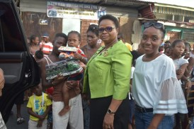 Minister of Public Health, Volda Lawrence distributing gifts to children who met her at the starting point at the junction of Hunter Street and Laing Avenue