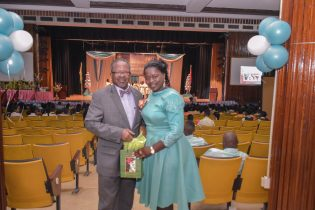 Professor Ivelaw Griffith, Principle and Vice Chancellor, University of Guyana (UG) receive a token from Tiffany Favourite-Harvey, acting Regional Education Officer (REdO)