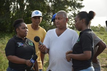One of the forest operators being shown how to conduct a noise nuisance test by Air Quality and Noise Management, Environmental Officer Avanelle Jackson (right) and Litter Prevention Warden, Carla Payne-Thomas