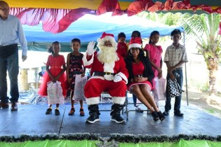 Santa and Mrs. Claus along with some of the children.