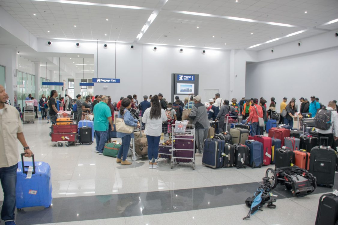 Passenger utilizing the new baggage facilities at the CJIA