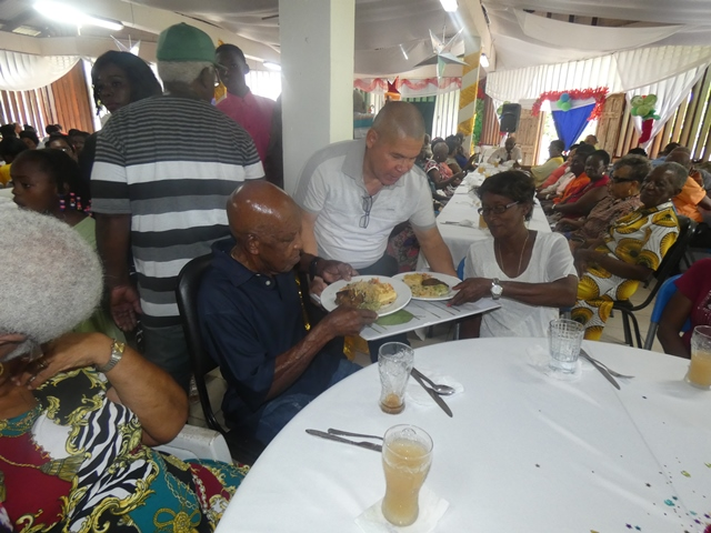 Minister of Social Cohesion Dr. George Norton serving the seniors.