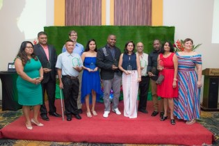Director, Guyana Tourism Authority Brian Mullis, (back row: light blue shirt) alongside this year's GTA awardees and Acting-Chair GTA Board Andrea de Caires (extreme right).