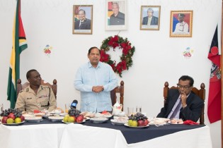 Prime Minister Moses Nagamootoo addressing the officers as Commissioner of Police Leslie James (left) and Minister of Public Security Khemraj Ramjattan (right)listen.