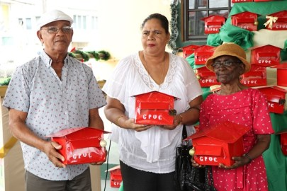 Virgil Moore, Simone Sooknanan and Cicely Clark, the first three lucky recipients of mailboxes from the Guyana Post Office Corporation (GPOC).
