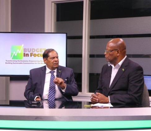 Prime Minister, Moses Nagamootoo [left] during the televised Budget in Focus programme on the National Communications Network with Host, Enrico Woolford [right].