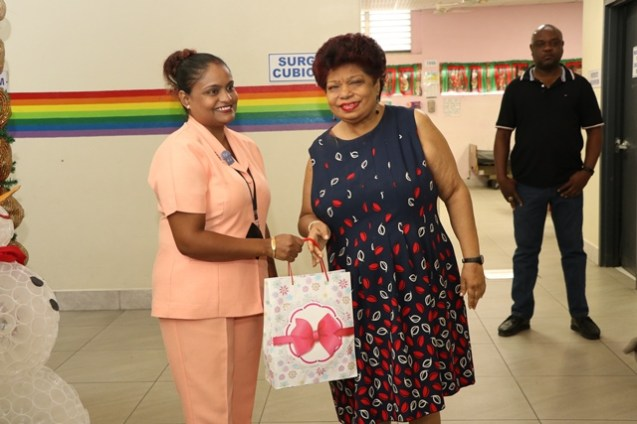 Minister of Social Protection Amna Ally distributing tokens to Georgetown Public Hospital Corporation (GPHC) staff.