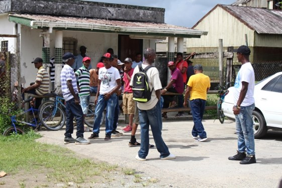Retrenched workers wait to collect their benefits.