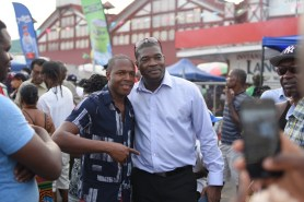 Government Ministers greet citizens at Stabroek Square.