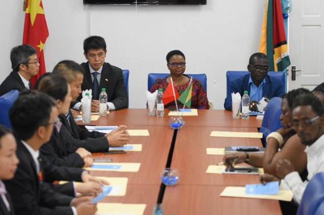 Members of the 14th Chinese Medical Brigade, administrative staff of the Georgetown Public Hospital seated around the table with Hu Hanming, Economic and Commercial Counsellor, Embassy, People's Republic of China, Minister of Public Health Volda Lawrence and Chief Executive Officer of the GPHC, Ret'd Brigadier George Lewis.