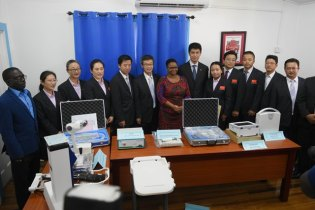Minister of Public Health, Volda Lawrence flanked by members of the 14th Chinese Medical Brigade with samples of the equipment which had been handed over.