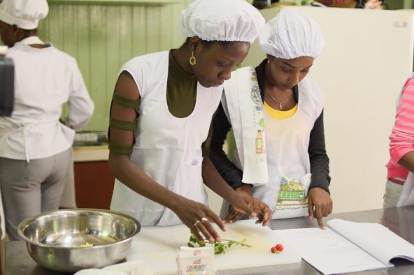 Two of the teenage mothers during their food preparation for their practical