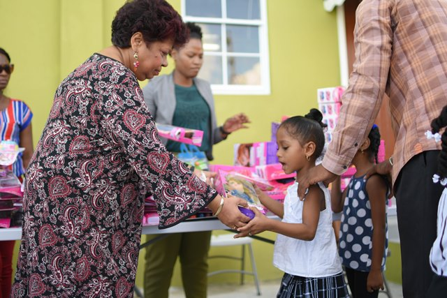 Minister of Social Protection, Amna Ally distributing gifts to the children.