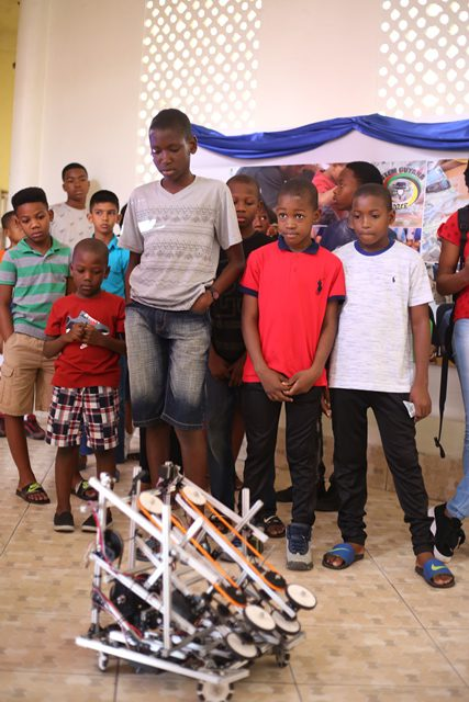 The participants being given a demonstration of one of STEM's robots.