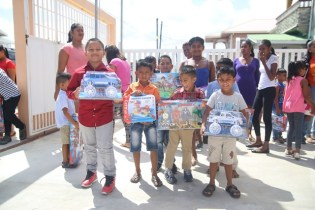 Some of the children from Lusignan with their presents.