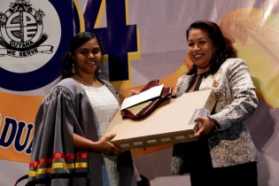 Best Graduating Student, Ms. Annamarie Isserdeen Samaroo receiving the Presidential Award of Excellence from Minister of Public Affairs, Hon. Dawn Hastings-Williams.