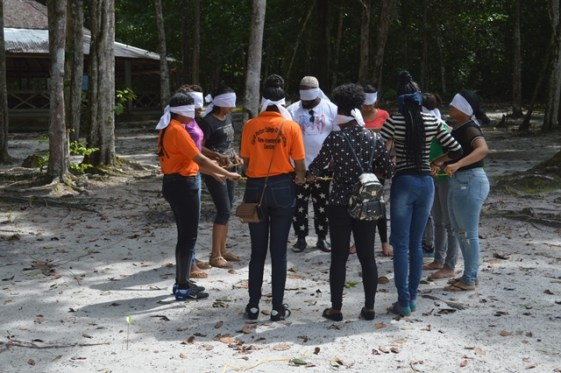 Participants during a team building exercise.