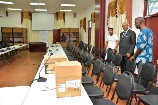 Minister of State, Mr. Joseph Harmon and Mr. Trevor Benn, Chief Executive Officer of the Guyana Lands and Surveys Commission examine meeting rooms, which are being set up at the Arthur Chung Convention Centre.