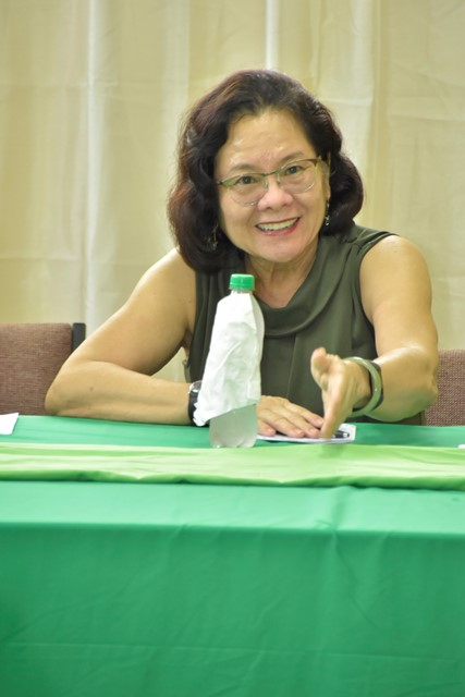 First Lady, Mrs. Sandra Granger gestures while making at point during the workshop.