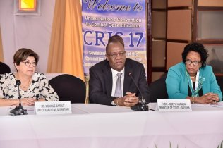 Minister of State, Mr. Joseph Harmon (centre) speaks to members of the media at the Arthur Chung Convention Centre today. He is flanked by Ms. Monique Barbut (left), Executive Secretary of the UNCCD and Mrs. Yolande Bain- Horsford, Minister of Agriculture and Lands of Grenada.