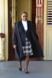 Chief Justice (ag), Roxane George entering the courtroom.