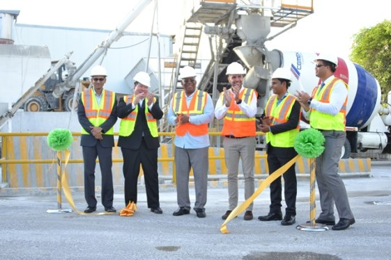 Minister of Finance Winston Jordan cutting the ceremonial ribbon to open the concrete plant alongside Mexico's Ambassador to Guyana, His Excellency, Ivan Roberto Sierra Medel, Business Manager of TGI Roger Ramdwar, General Manager of Arawak Cement Company Limited Yoga Castro Izaguirre and TCL Guyana Incorporated, President of Guyana Manufacturing and Services Shyam Nokta and Guyana Office for Investment (Go-Invest) Chief Executive Officer, Owen Verwey.