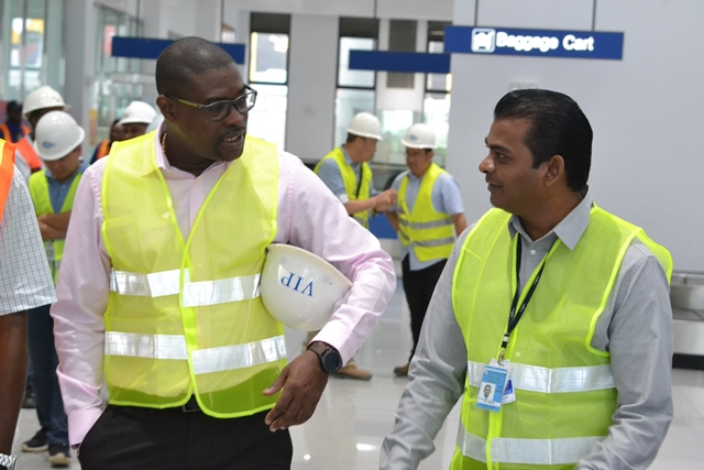 Minister of Public Infrastructure, David Patterson speaks with CJIA CEO, Ramesh Geer during a tour of the CJIA Expansion Project.
