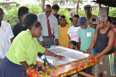 Minister within the Ministry of Communities, with responsibility for Housing, Valerie Adams-Yearwood meeting with squatters at Belle West, Canal No. 2, W.B.D.