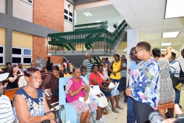 Minister of Public Health, Volda Lawrence speaking to a number of patients on their progress