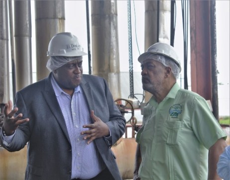EPA Director Dr Vincent Adams listens to a point being made by Master Distiller Sean Caleb during the visit to DDL operations at Diamond.