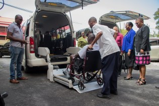 A patient of the Palms Geriatric Home being lifted into one of the bus in a demonstration exercise.