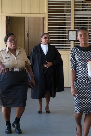 Chief Justice (ag) Roxanne George (centre) heading to the courtroom earlier today..