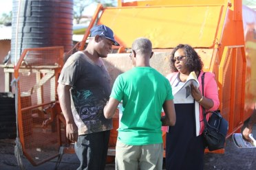 Minister within the Ministry of Public Health, Dr. Karen Cummings interacting with the people.