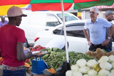 Minister of Business, Dominic Gaskin listening to the concerns of a vendors at Bourda Market.