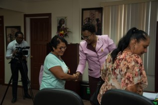 Minister within the Ministry of Public Infrastructure, Annette Ferguson greets Timehri residents before commencing discussions.