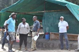 Minister within the Ministry of Natural Resources, Simona Broomes and her team during the site visit.