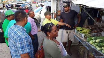 REO Jaikaran interacting with vendors at the Charity Marketing Centre.