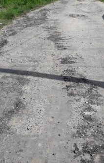 Damage done to access street to village and public road.