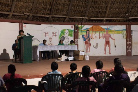 Minister Ally address youths in St. Ignatius (from left) as Minister of Public Telecommunications, Catherine Hughes, Minister of Public Affairs, Dawn Hastings Williams, and Regional Executive Officer, Region Three, Jennifer Ferriera Dougall listen