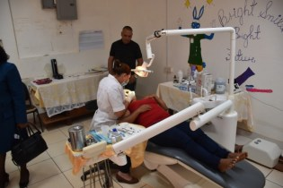 Dentist attends to a patient in the dental department of the hospital.