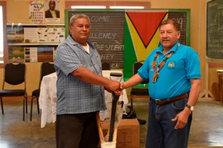 Toshao of Toka, Eugene Issacs receiving farming implements from Minister of Indigenous Peoples' Affairs, Sydney Allicock.