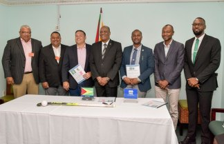 Minister of State, Mr. Joseph Harmon (centre) surrounded by executive members of the Guyana Football Federation (right) and the Guyana Hockey Board (left) while Director of Sport, Mr. Christopher Jones is at the extreme right.