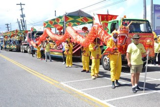 A Glimpse of the Chinese Association of Guyana Band marching for the first time at Mash 49.